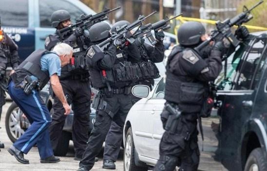 Authorities surround the Watertown house where Dzokhar Tsarnaev is believed to be.